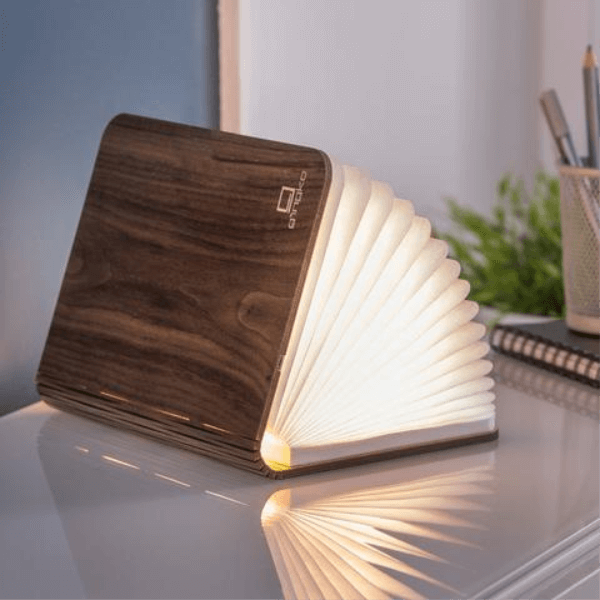 A small wooden book with pages that light up when you open it.
