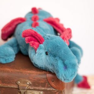A cuddly dragon toy from Jellycat
