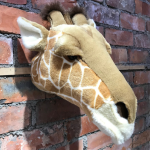 A wall mounted animal head to decorate a bedroom or nursery