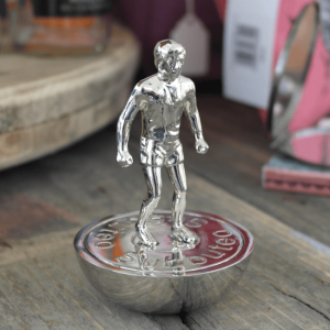 a silver subbuteo figure that is a bottle opener