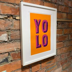 A print with the abbreviation YOLO on it meaning you only live once.