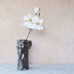 A flower vase that looks like an elephant