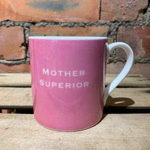 A pink mug with Mother Superior Printed on it.