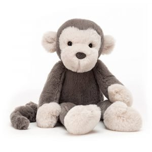 A jellycat soft toy monkey with cute cream ears and face and a soft brown body