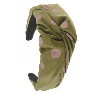 A wide Alice band for your hair. Covered with sage green fabric with pink big polka dots with a knot twist at the top.