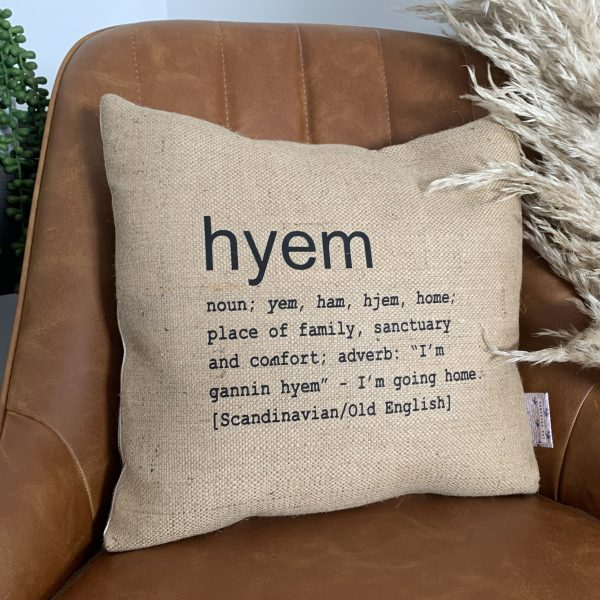 A North East inspired cushion made from hessian and backed with striped ticking. The cushion has a colloquial dictionary quote of what Hyem means.