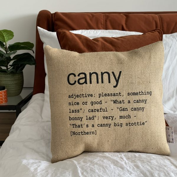 A North East inspired cushion made from hessian and backed with striped ticking. The cushion has a colloquial dictionary quote of what Canny means.