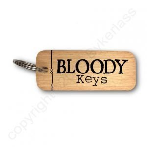 Wooden key ring with Bloody Keys printed on it in black