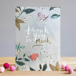 A beautiful thank you card with flowers and butterflies in soft tones