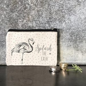 Small canvas coin purse in cream with coral and grey dots. A flamingo and the words splash the cash are printed on both sides in grey. A really cute coin purse with a black lining and zip fastening
