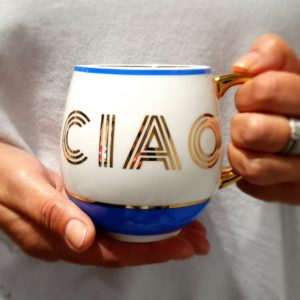 China mug in blue and gold. Gold handle and gold text CIAO