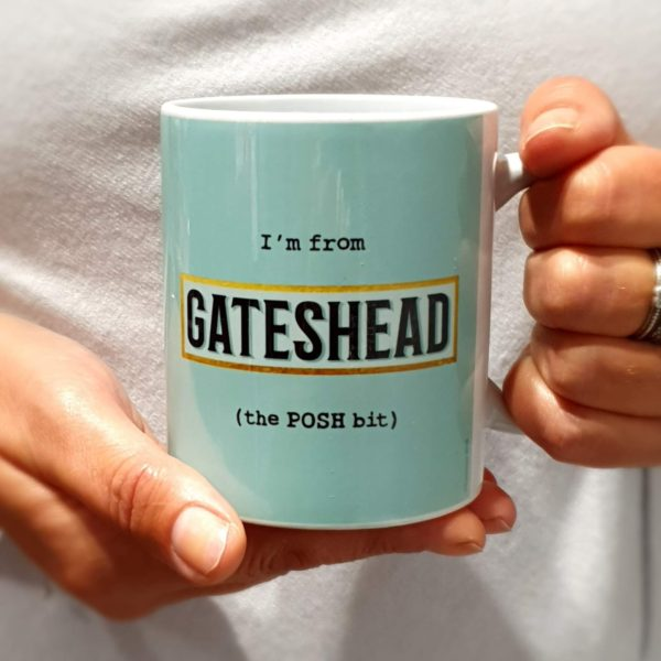A classic shaped mug printed with I'm from Gateshead (the POSH bit) with a blue background