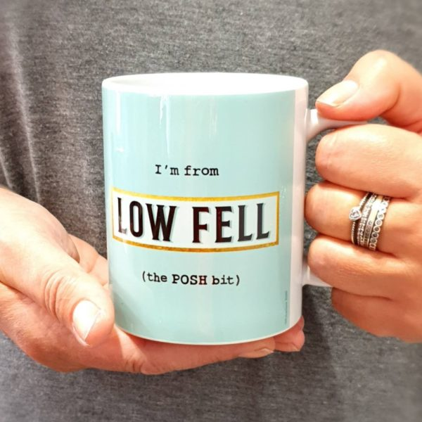 A classic shaped mug printed with I'm from Low Fell (the POSH bit) with a blue background