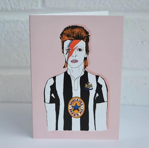 Quirky greetings card for any occasion with an illustration of David Bowie wearing a newcastle united football top