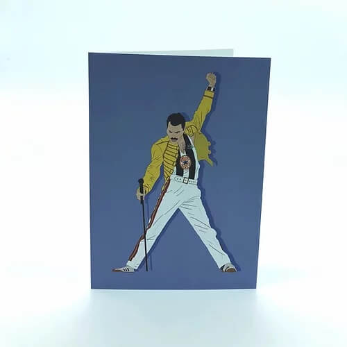 a greetings card with freddie mercury in his classic pose wearing a newcastle united football top