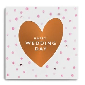 Copper foilded wedding card. A big copper heart with pink dotty background with happy wedding day