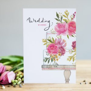 A rectangular card with an image of a wedding cake with a pink floral theme, which is in a vintage style.