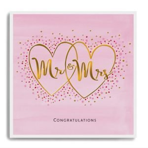 A pink card printed in embossed gold foil with Mr and Mrs and decorated with small gem stones