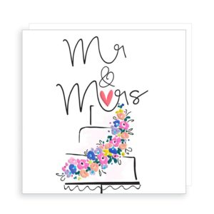 A white square card with the wording Mr & Mrs and a cake printed in black gloss ink. There are very colourful neon coloured flowers across the front of the cake and a bright pink heart on top of the cake.