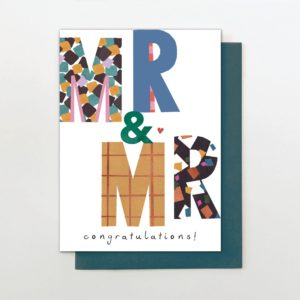 A rectangular card with the words Mr & Mr printed in bright coloured patterned letters which have a shimmer to them too.