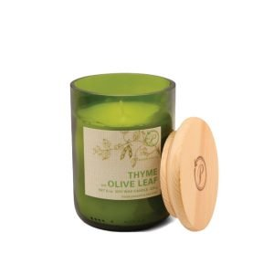 A green glass jar eco friendly candle with a label saying Thyme and Olive Leaf. The candle has a bamboo lid.