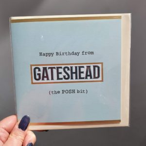 square greetings card in minty blue with Happy birthday from Gateshead (the POSH bit)?. A fun birthday card