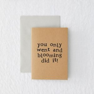 A recycled brown kraft card which has the words 'You Only went and blooming did it' printed in black typewriter font.