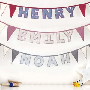 Personalised name bunting in a choice of pink, blue or grey star patterned cotton fabric.
