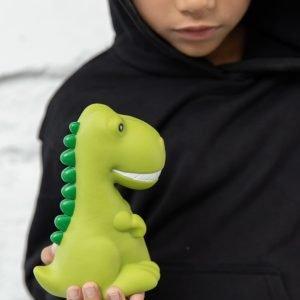 A rubber night light green dinosaur being held by a little boy.