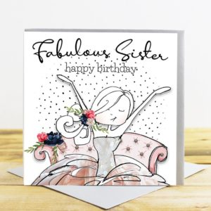 A white square card with a picture of a girl with long hair and a tutu style dress with flowers and sequins in her hair. She's sitting on a sofa and there are dots in the background. The words Fabulou Sister Happy Birthday printed above the image.