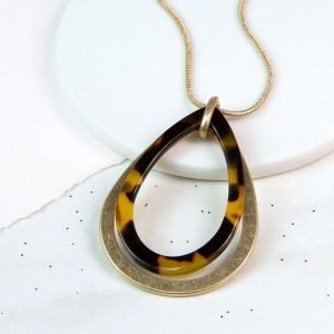 Gold snake chain necklace with a gold and animal print resin teardrop pendant