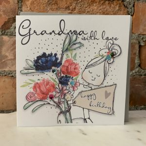 A white square card with a picture of a lady wholding a huge bunch of flowers finished with glitter and sequins