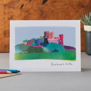 Beautiful illustration of Bamburgh Castle on a blank greetings card.