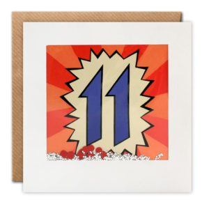 A square card with a white border and a cellophane packet which holds glitter and confetti inside it. Behind it is an image of the number 11 in a graffiti style. When you shake the card the confetti moves around giving a shakies effect.