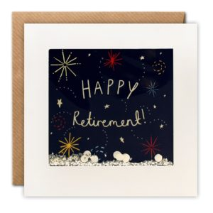 A square white card with a framed area which has cellophane inset into it. Behind the cellophane is an illustration of fireworks in the sky with a black background and the words Happy Retirement printed in the centre of it. The card has a brown kraft envelope with it.