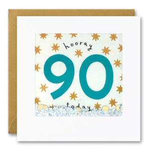 A white square card which has a clear plastic square area on the front of the card. The words Hooray 90 today are printed on the card behind the clear plastic. There is silver glitter and cream dot confetti inside the packet which means that if you shake it the confetti moves around.