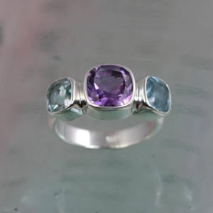 Violet amethyst and blue topaz silver ring