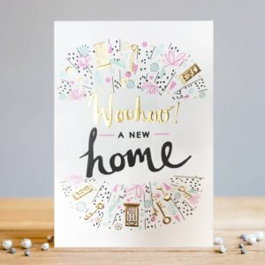 A white rectangular card with the wording Woohoo! A New Home embossed and printed in the centre of the card. All around the wording are images of doors, keys and flowers.