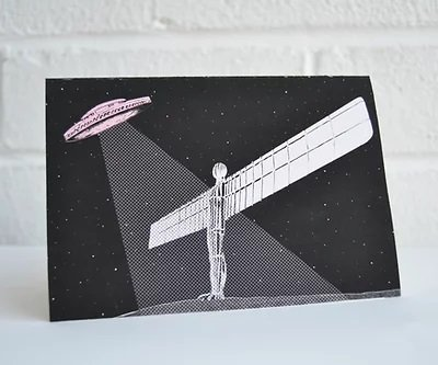 a blank greeting card with an illustration of an alien flying saucer over the Angel of the North