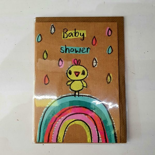 A baby shower greetings card with a childish crayon drawing of a chick standing in a rain shower on top of a rainbow