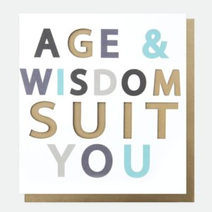 A designer typographic birthday card from Caroline Gardner. A white card with Age and Wisdom suit you in colourful letters with some of the letters being punched out.