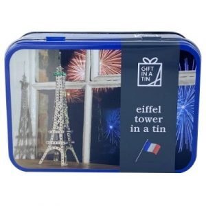 A tin containing all the parts, tools and instructions to build a 40cm high metal model of the Eiffel Tower