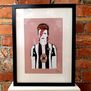 A print of David Bowie wearing a Newcastle United football top