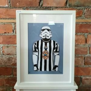 an a4 print of an illustration of a stormtrooper wearing a newcastle united football top