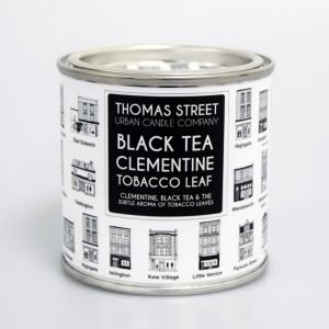 A hand poured black tea and clementine scented soy wax candle from Thomas Street. Hand poured in England