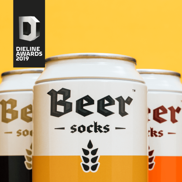 An image of 3 cans that look like beer but inside of the cans are socks which look like beer.