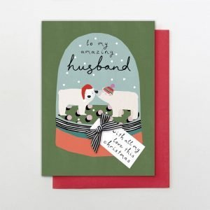 """A hand finished Christmas card for a husband with a cute drawing of a pair of polar bears in a snow globe. Finished with a black and white ribbon bow with the words """"to my amazing husband"""" and a little label that reads """"with all my love this Christmas"""""""