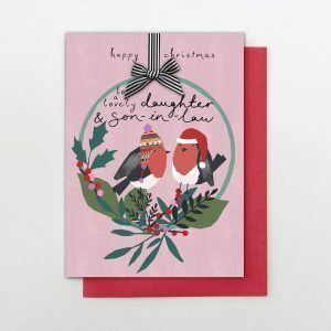"""A Christmas card for a lovely Daughter and Son in Law. With a pair of robins in winter hats in a Christmas flower hoop drawn in the Stop the Clock style on a pink background. With the words """"happy Christmas to a lovely Daughter and Son in Law"""""""