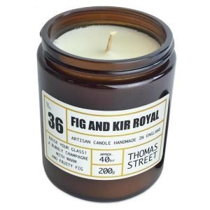 Fig and kir royale Soy wax candle in a glass apothecary jar with a lid.