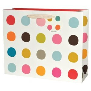 A large gift bag which has multi coloured spots all over it. With a natural coloured ribbon handle and a spotty tag.